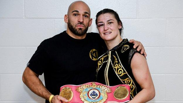 Katie Taylor (right) poses with trainer Ross Enamait and the WBO super-lightweight belt