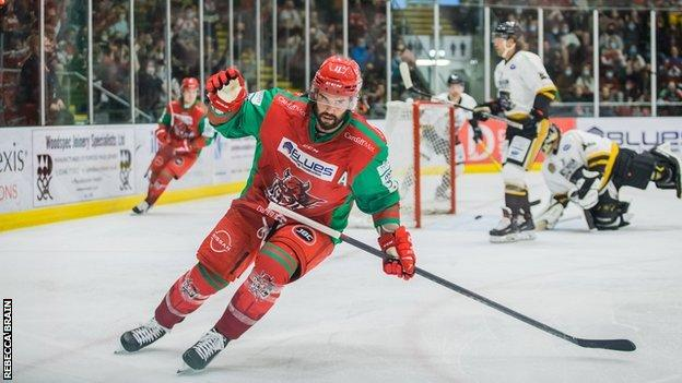 Cardiff Devils forward Stephen Dixon scores the first goal of a weekend double header with Nottingham Panthers