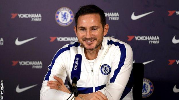 Chelsea manager Frank Lampard smiling at a press conference
