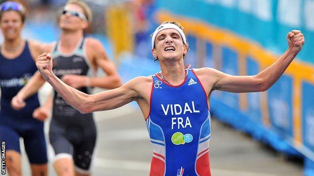 Laurent Vidal celebrates victory in a Triathlon World Series event