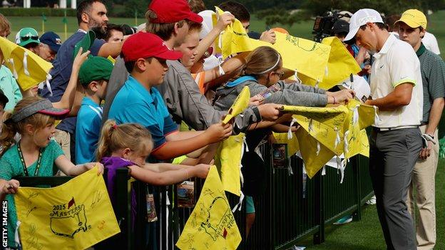 Rory McIlroy signs autographs at The Masters