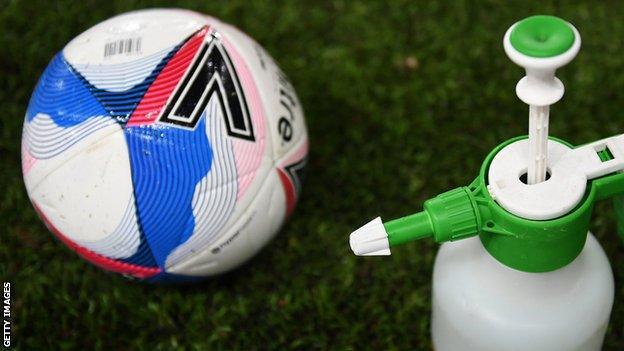 Football and hand sanitiser