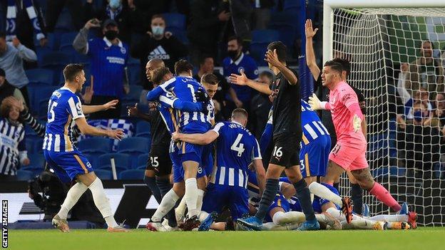Brighton players celebrate Dan Burn's winning goal