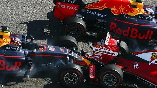 Daniil Kvyat crashes into Ferrari's Sebastian Vettel