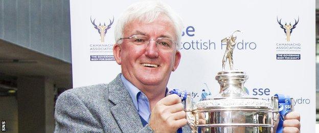 Hugh Dan MacLennan with the Camanachd Cup