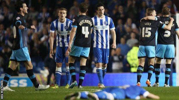 Brighton's players after their play-off semi-final defeat by Sheffield Wednesday