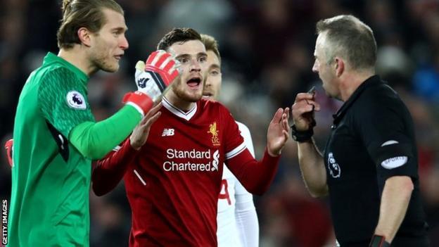 Loris Karius challenges the referee