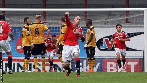 Kevin Ellison celebrates a goal against Newport, one of 15 he was directly involved with for Morecambe against his new club