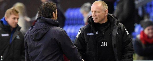 Dundee's Paul Hartley and Caley Thistle's John Hughes shake hands