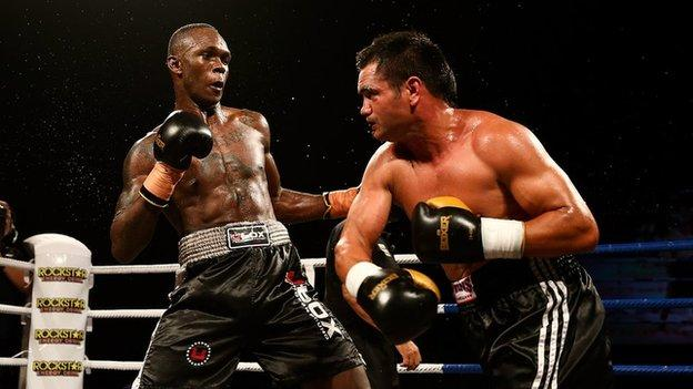 Israel Adesanya (L) fights Lance Bryant (R) during Super8 Fight Night on March 28, 2015 in Christchurch, New Zealand.