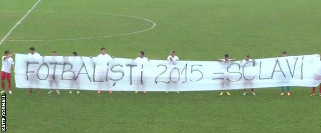 Romanian second division team Metalul Resita displayed a banner in protest at the treatment of players
