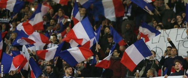 France fans show their support during the first half