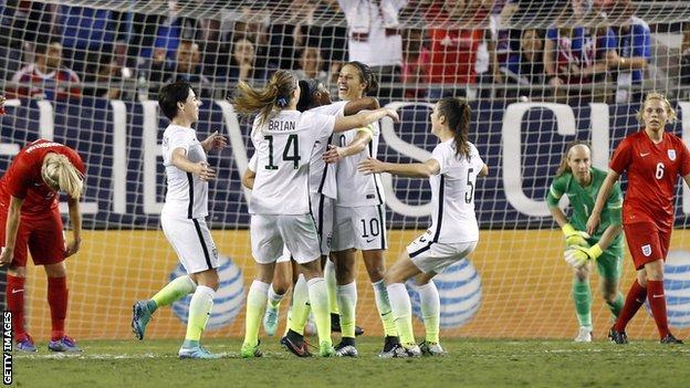 The US celebrate Dunn's winner