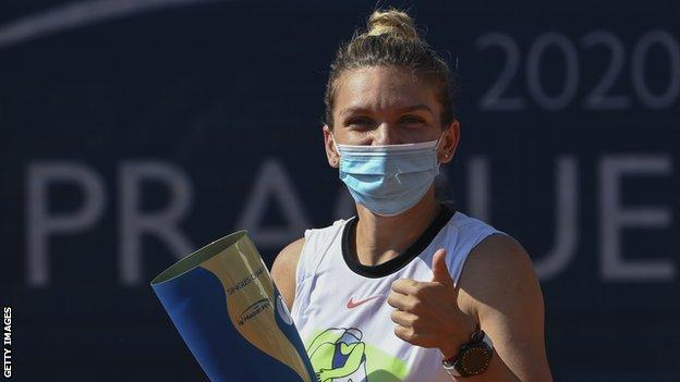 Simona Halep with her Prague Open trophy after beating Elise Mertens last weekend