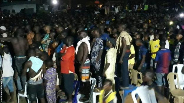 A crowd in the Nigerian town of Sagamu watch Anthony Joshua's second fight against Andy Ruiz Jnr