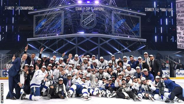The Tampa Bay Lightning celebrate with the Stanley Cup
