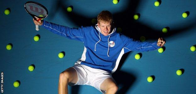 Kyle Edmund poses for the cameras before playing in the Junior Davis Cup in 2011