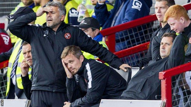 United coaches Darren Jackson and Simon Donnelly look just as dejected as manager Jackie McNamara