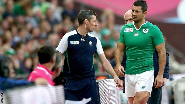 An injured Rob Kearney leaves the Wembley pitch for treatment