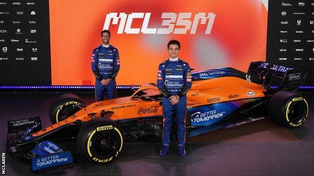 Daniel Ricciardo and Lando Norris with McLaren's car for the 2021 season