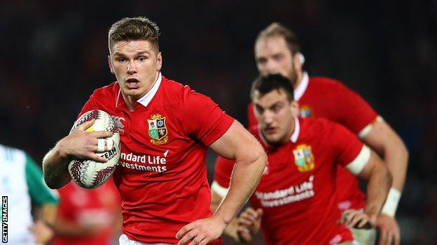 Owen Farrell runs with the ball while playing for the Lions