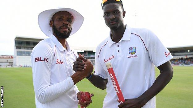 Roston Chase and Jason Holder celebrate West Indies' victory in the first Test