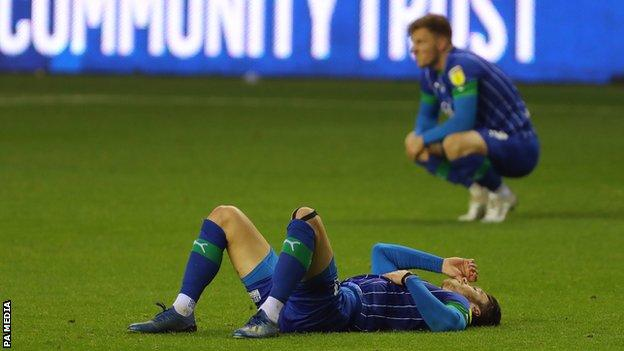 Dejected Wigan players