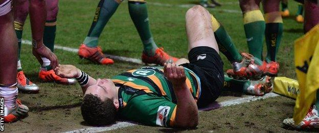 George North lies on the floor after suffering a blow to the head during Northampton's 52-30 win against Wasps in March 2015