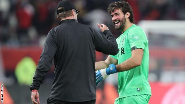 Liverpool keeper Alisson celebrating with Jurgen Klopp