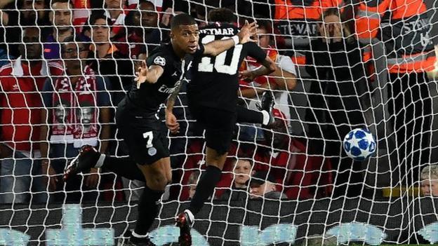 Kylian Mbappe celebrates scoring for Paris St-Germain against Liverpool