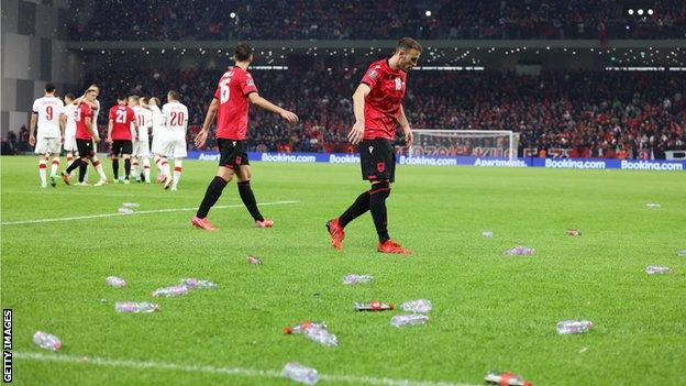 Bottles are thrown on to the pitch