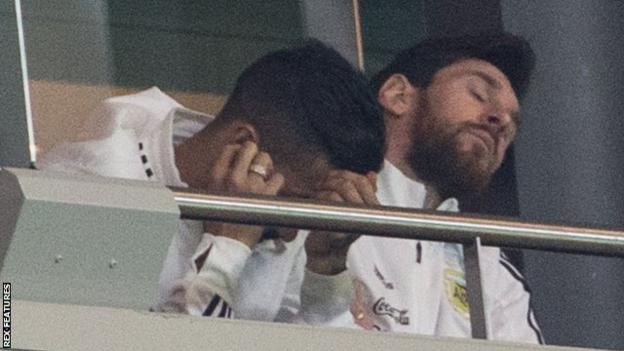 Lionel Messi (right) reacts as Argentina capitulate against Spain