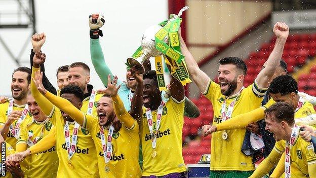 Norwich City players celebrate winning the Championship
