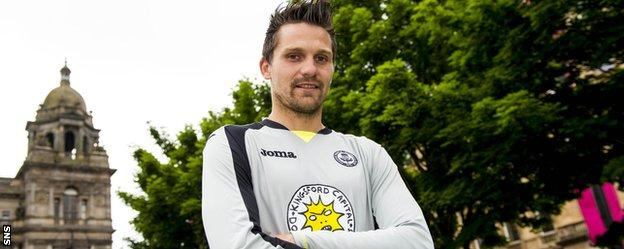 Tomas Cerny sports Partick Thistle's new sponsorship logo and mascot