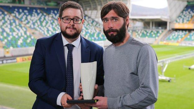 Gary Hamilton receives the October award from NI Football Writers' Association chairman Keith Bailie