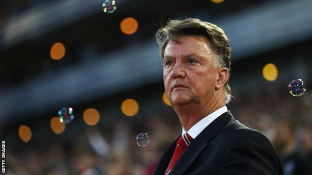 Louis van Gaal surrounded by bubbles at West Ham