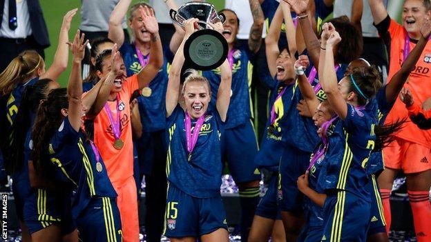 Alex Greenwood celebrating winning the Champions League
