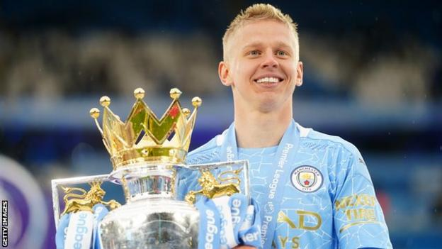 Oleksandr Zinchenko celebrates with the Premier League trophy in May 2021