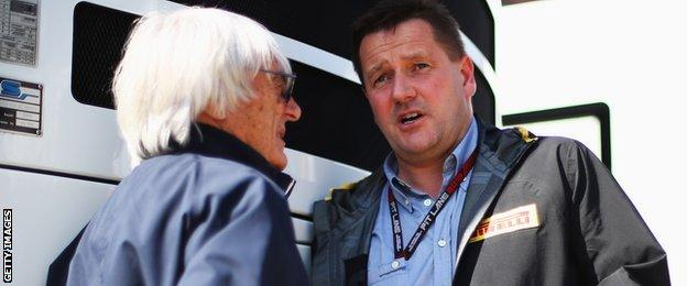 F1 boss Bernie Ecclestone talks to Pirelli Motorsport director Paul Hembery