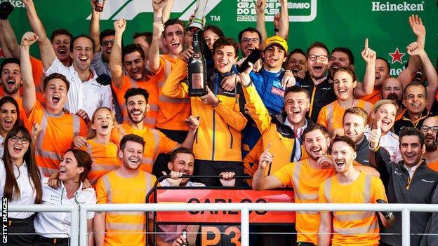 Carlos Sainz and Lando Norris with McLaren staff