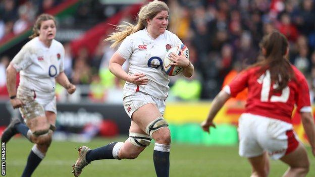 England's Poppy Cleall runs with the ball