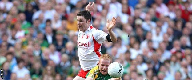 Enda McGinley battles with Kerry's Seamus Scanlon in the 2008 All-Ireland final