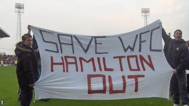 Wrexham fans protest against club owner Alex Hamilton