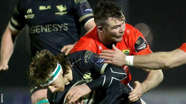 Munster's Peter O'Mahony tackles Connacht's Ben O'Donnell at The Sportsground