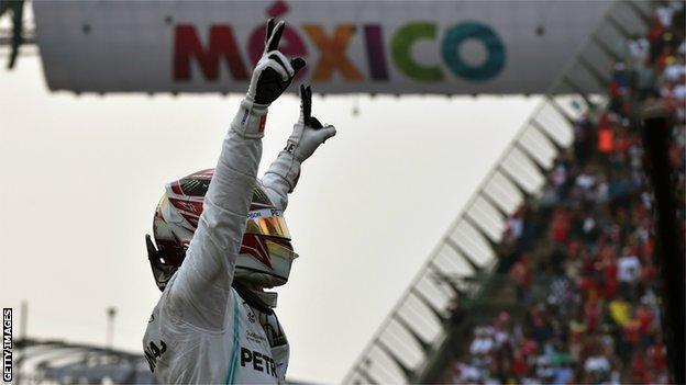 Lewis Hamilton salutes the crowd