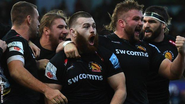 Exeter celebrate their opening try against Saracens