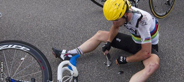 Mark Cavendish reacts on the ground after a crash at the end of the fourth stage of the 2012 Tour de France