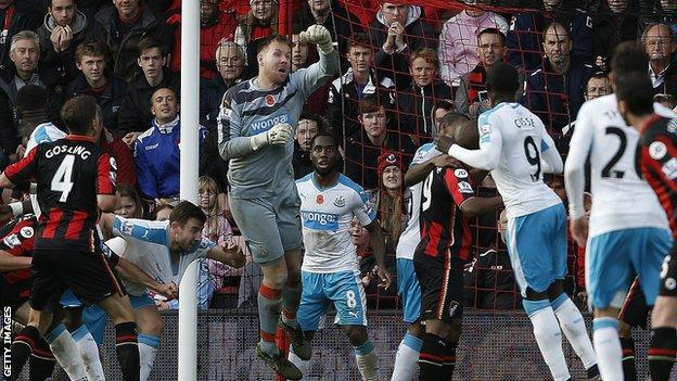 Rob Elliot (in grey) punches clear at Bournemouth