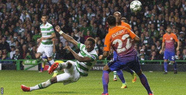 Moussa Dembele hooks in Celtic's third goal against City