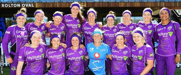 Sophie Devine with the Hobart Hurricanes squad